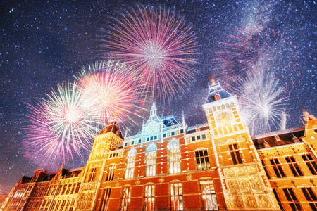 Beautiful calm night view of Amsterdam city. Colorful fireworks on the black sky background. Photo greeting card. Bokeh light effect, soft filter. Stock Photo