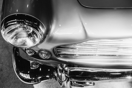 closeup of the headlights and front bumper on  vintage automobile Reklamní fotografie