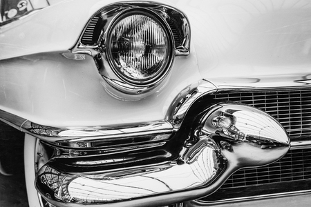 closeup of the headlights and front bumper on  vintage automobile Фото со стока - 85812004