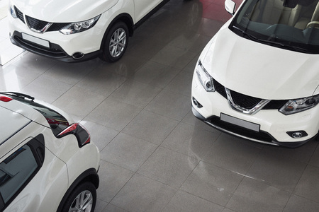 Car sales, marketplace, shot at wide angle.