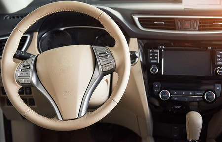 Luxury car Interior - steering wheel, shift lever, dashboard and computer. Stock Photo