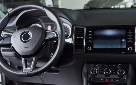 Luxury car Interior - steering wheel, shift lever, dashboard and computer. Stock Photo - 85857189