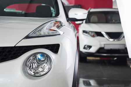 The headlights and the hood of a new luxury car. Stock Photo