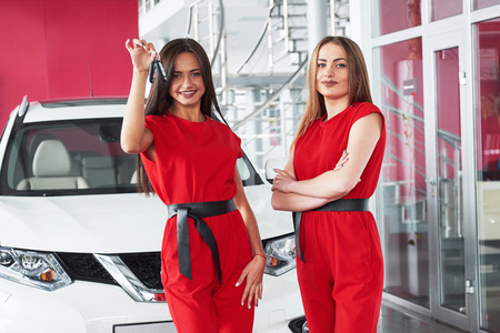 Young happy two woman near the car with keys in hand - concept of buying car Stock Photo - 85894903