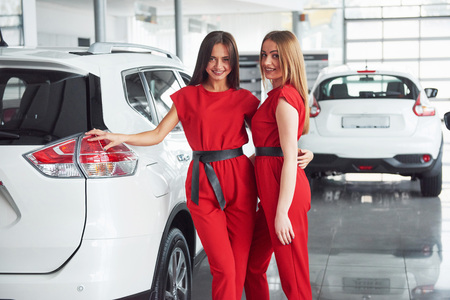 Young happy two woman near the car with keys in hand - concept of buying car Stock Photo - 86168123
