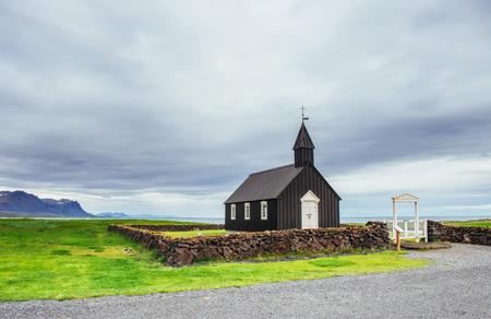 Mountain View Iceland. Beautiful black wooden church in Budir.