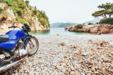 Panoramic views of the coastline. Motorcycle on the beach. The world of beauty. Turkey Imagens