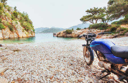 Panoramic views of the coastline. Motorcycle on the beach. The world of beauty. Turkey Banco de Imagens