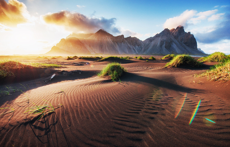 Fantastic west of the mountains and volcanic lava sand dunes on the beach Stokksness, Iceland Stock Photo - 85821706