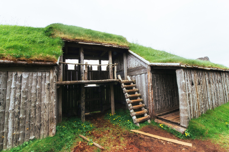 Traditional Viking village. Wooden houses near the mountain first settlements in Iceland Stock Photo