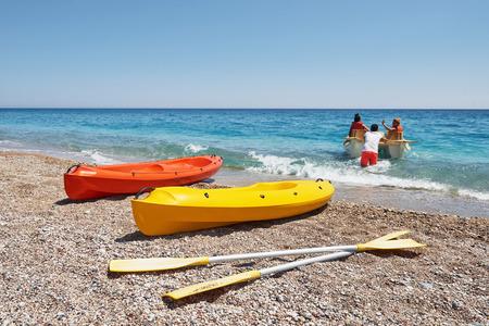 Colorful kayaks on the beach. beautiful landscape. Stock Photo