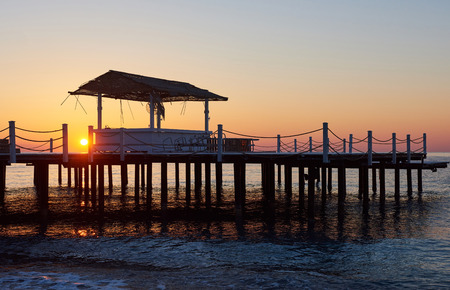 Wooden bridge pier against a beautiful sky measure used for natural background, background and multi-stage sea