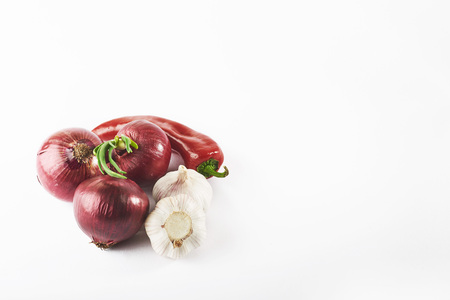 blue onion garlic and hot red pepper isolated on white background Stock Photo