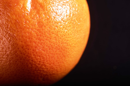macro fresh orange peel on a black background.