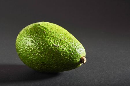 Fresh delicious avocado isolated on a black background