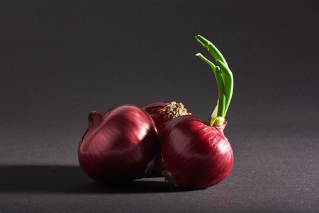 Red onions whole, isolated on a black background. Stock Photo