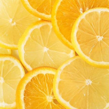 slices of orange and lemon isolated on a white background.