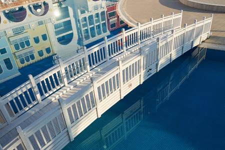 beautiful white wooden bridge over water Stock Photo