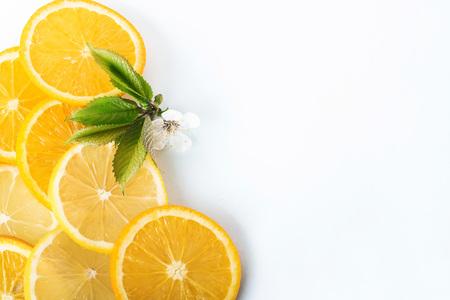 slices of orange and lemon isolated on a white background