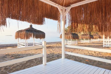 White chairs on the beach resort famous Amara Dolce Vita Luxury Hotel. Resort. Tekirova-Kemer. Turkey. Stok Fotoğraf - 86264906
