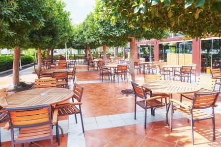 Empty served restaurant table waiting for visitors is located on the beach. Amara Dolce Vita Luxury Hotel. Resort. Tekirova-Kemer Stok Fotoğraf - 86670541