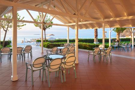 Empty served restaurant table waiting for visitors is located on the beach. Amara Dolce Vita Luxury Hotel. Resort. Tekirova-Kemer