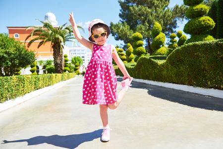 Portrait of a happy child wearing sunglasses outdoors in summer day. Amara Dolce Vita Luxury Hotel. Resort. Tekirova-Kemer. Turkey. Stok Fotoğraf - 86264920