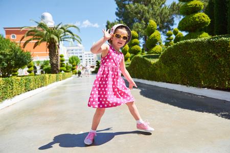 Portrait of a happy child wearing sunglasses outdoors in summer day. Amara Dolce Vita Luxury Hotel. Resort. Tekirova-Kemer. Turkey. Stok Fotoğraf - 86264921