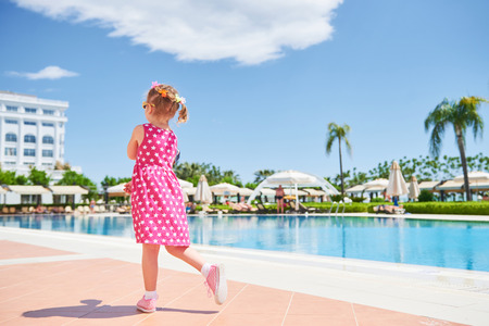 Portrait of a happy girl outdoors in summer day. Amara Dolce Vita Luxury Hotel. Resort. Tekirova-Kemer. Turkey. Stok Fotoğraf - 86264926
