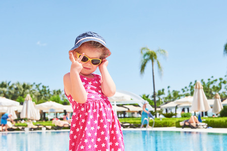 Portrait of a happy girl outdoors in summer day. Amara Dolce Vita Luxury Hotel. Resort. Tekirova-Kemer. Turkey. Stok Fotoğraf - 86264940