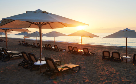 Scenic view of sandy beach on the beach with sun beds and umbrellas open against the sea and mountains. Amara Dolce Vita Luxury Hotel. Resort. Tekirova-Kemer Stok Fotoğraf - 86264945
