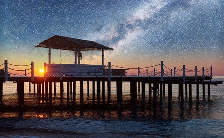 Beautiful view of wooden pier in the sea and starry sky and the Milky Way Reklamní fotografie