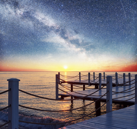 Good views of the White pier under the stars used to natural background Sea Stock Photo