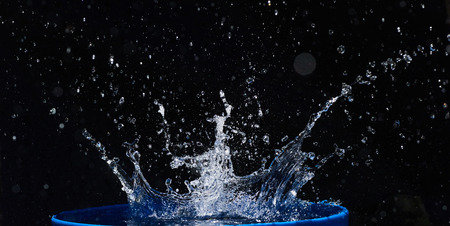 Blue water drops falling down. Stock Photo