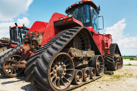 Harvesters and combine parts at the plant are waiting for sales, tractors and agricultural machinery, maintenance and exports Stock fotó - 86477820