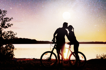 Couple on water background at night sky. Fantastic starry sky and the milky way.