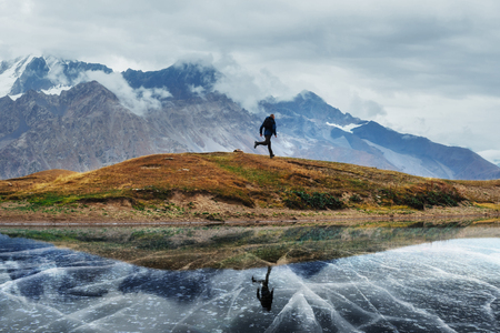 Landscape on mountain frozen lake Koruldi. Upper Svaneti, Georgia, Europe. Caucasus Stock Photo