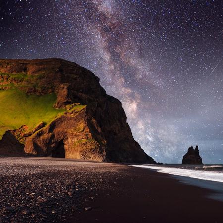 Famous Reynisdrangar rock formations at black Reynisfjara Beach. Coast of the Atlantic ocean near Vik, southern Iceland