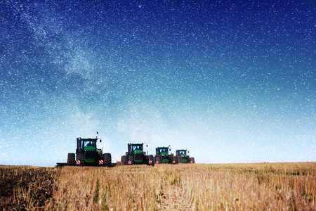Tractor plowing farm field in preparation for spring planting. Fantastic starry sky and the milky way Stok Fotoğraf - 86805819