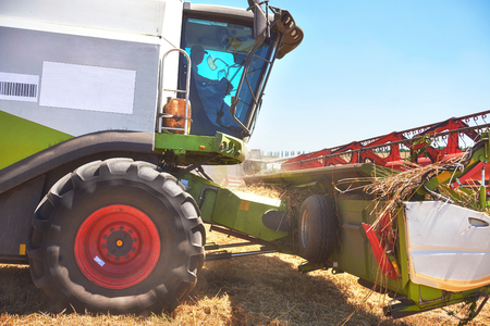 close view of modern combine harvester in action