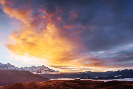 Sunset on mountain lake Koruldi. Upper Svaneti, Georgia, Europe. Caucasus mountains. Stock Photo