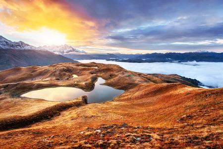 Sunset on mountain lake Koruldi. Upper Svaneti, Georgia Europe. Caucasus mountains Stock Photo