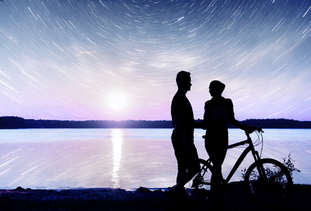 crater lake: Couple on water background at night sky. Fantastic starry sky and the milky way.