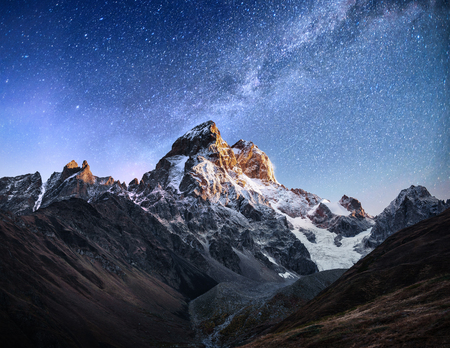 caucas: Fantastic starry sky. Autumn landscape and snow-capped peaks. Main Caucasian Ridge. Mountain View from Mount Ushba Meyer, Georgia. Europe