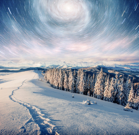 starry sky in winter snowy night. fantastic milky way in the New Years Eve. Courtesy of NASA. In anticipation of the holiday. Dramatic scene. Carpathian. Ukraine