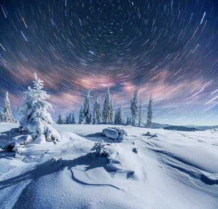 starry sky in winter snowy night. fantastic milky way in the New Years Eve. In anticipation of the holiday. Dramatic scene. Carpathian. Ukraine