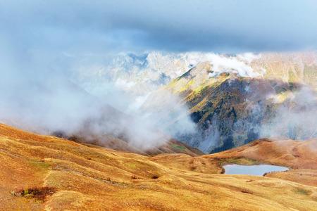Majestic mountain landscape. Koruldi lakes and a tourist admiring the view. Active life concept 版權商用圖片