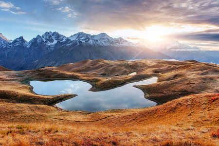 Sunset on mountain lake Koruldi. Upper Svaneti, Georgia, Europe. Caucasus mountains