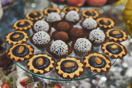 delicious colorful cookies and cakes on the wedding candy bar.