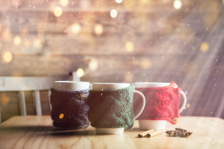 Christmas background with three cups of hot tea, valentines day. Happy new year.
